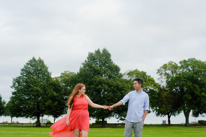 Boston couple engagement wind blowing pink dress