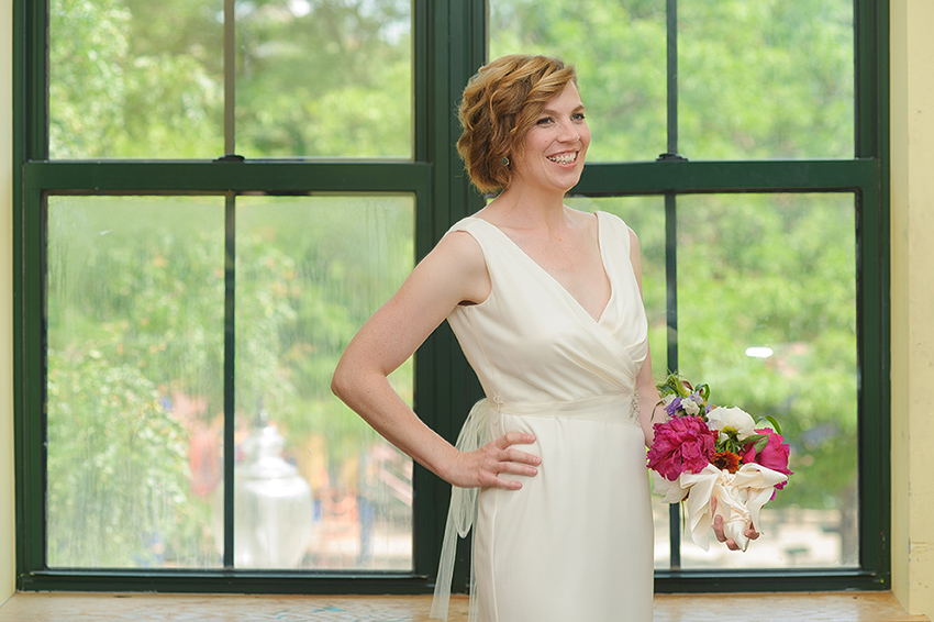 Villa Victoria Center for the Arts bride portrait in front of big window