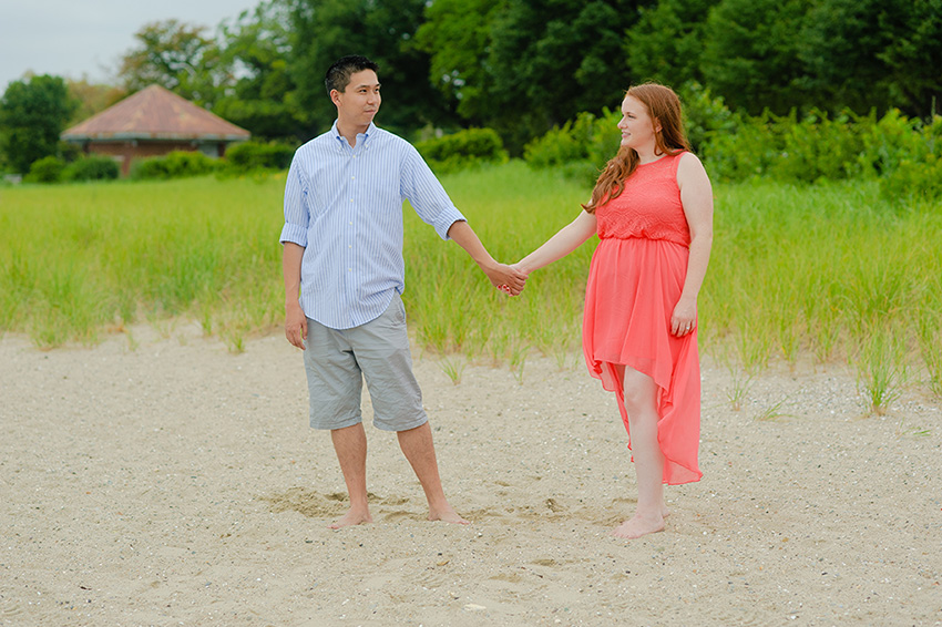 beach engagement session and pink dress