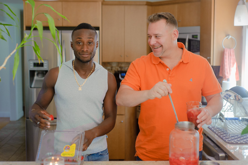 LGBT couple candid engagement session at home