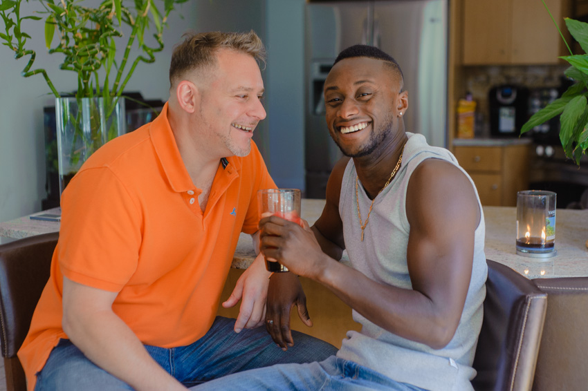 fun gay couple in home lifestyle session