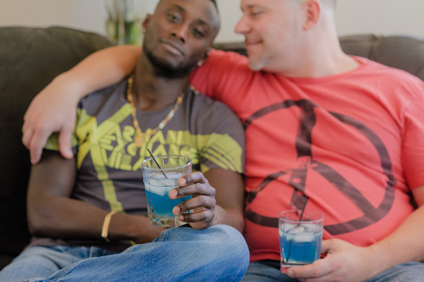 gay couple holding blue drink