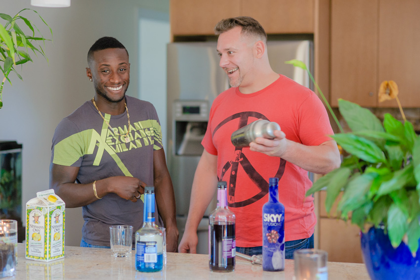 gay couple lifestyle photo session at home making a drink