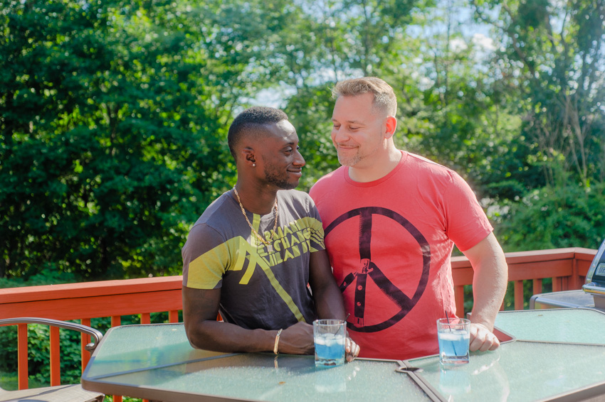 gay couple photo session in patio bar