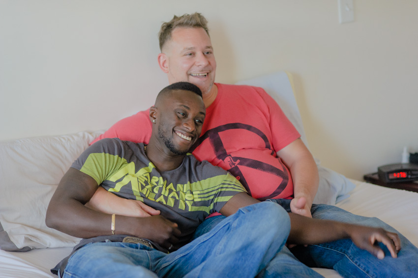 happy gay couple photo session in bed