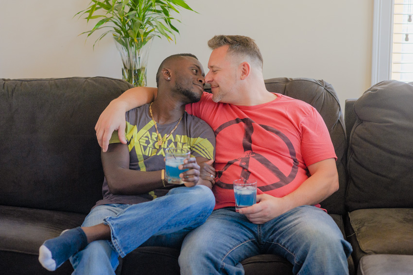 interracial handsome gay couple engagement at home