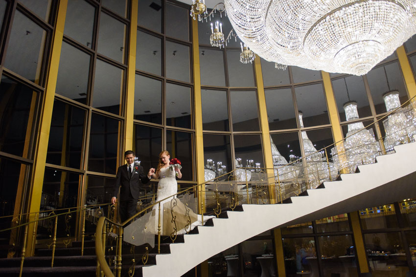 Lombardos wedding chandelier staircase