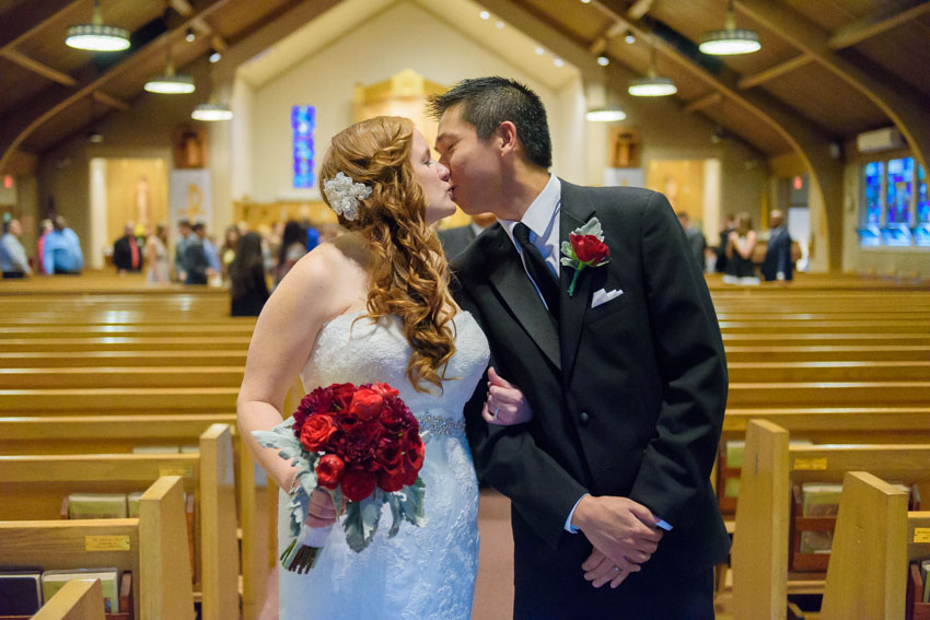 St. Bernadette Church wedding bride groom kiss