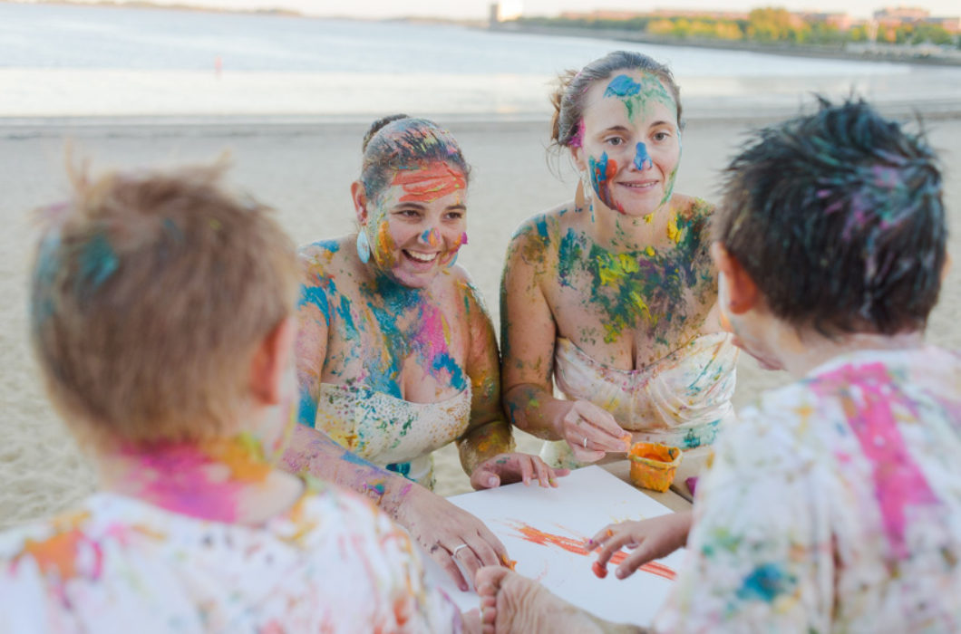 lesbian family paint war on Carson Beach