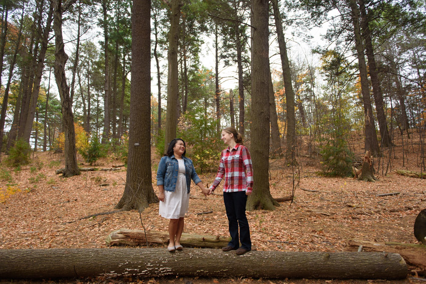 lesbian couple engagement in the woods
