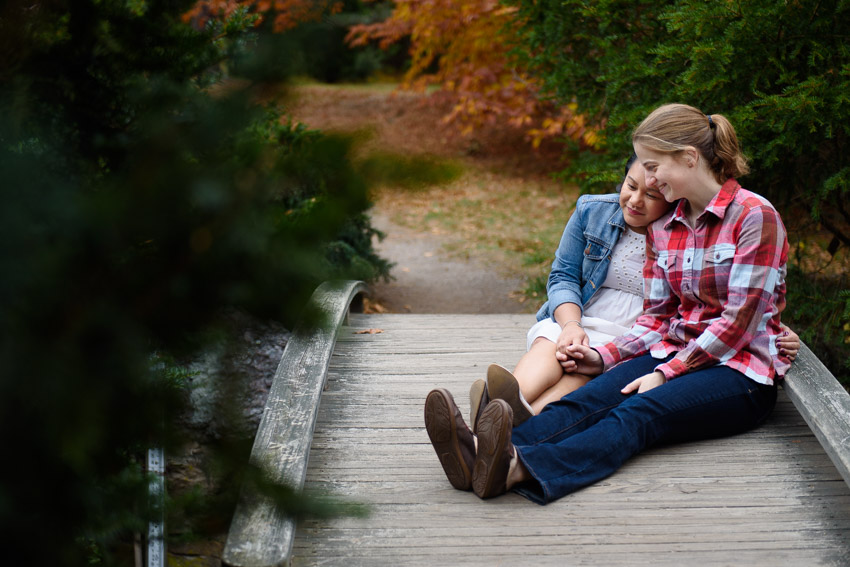 lesbian engagement session on bridge