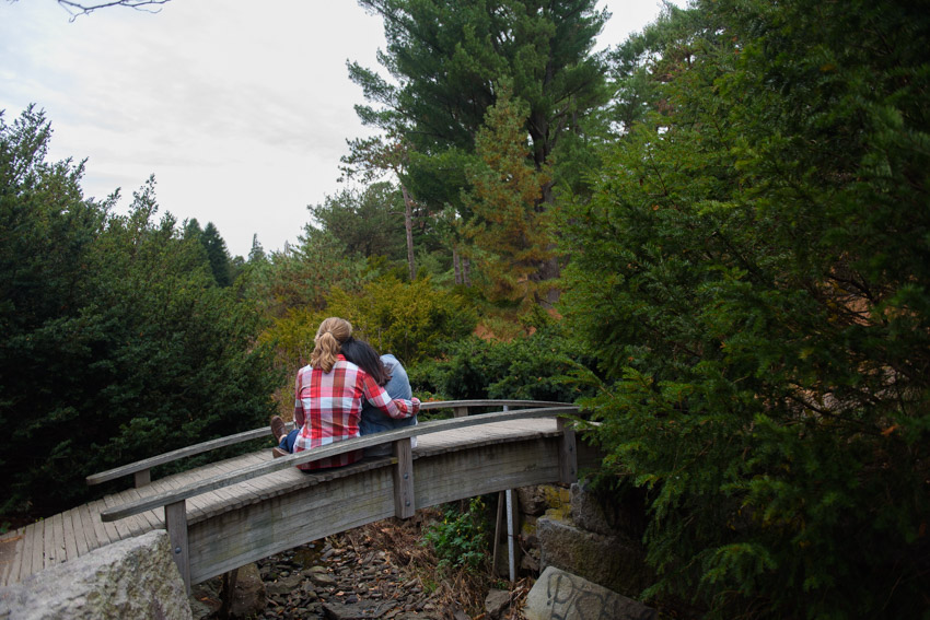 intimate engagement session on a bridge