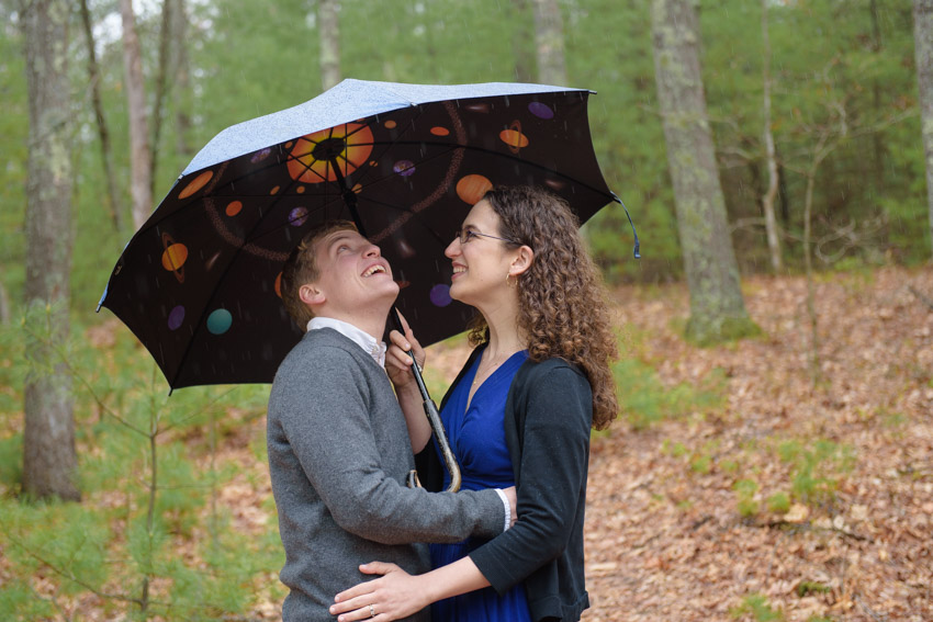 couple with science planet umbrella