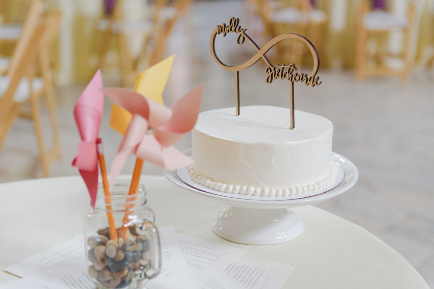 white wedding cake with infinity sign