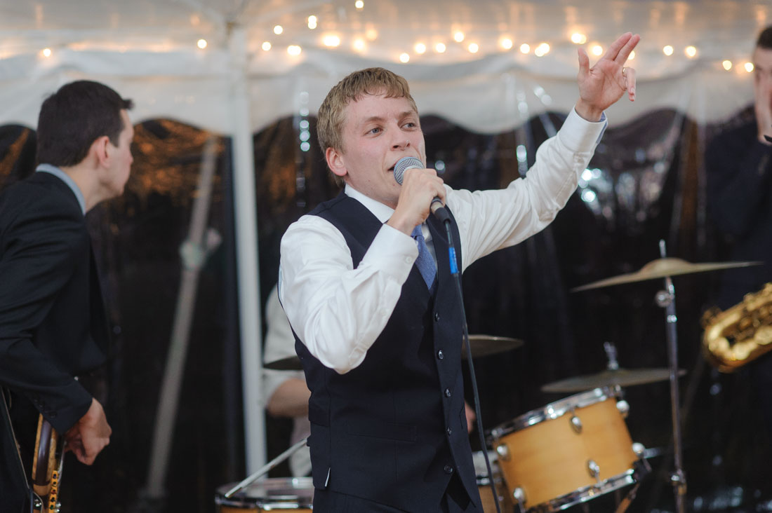 groom singing rap at wedding